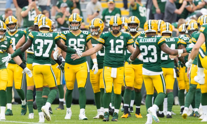 Aug 16, 2018; Green Bay, WI, USA; Green Bay Packers quarterback Aaron Rodgers (12) greets teammates during warmups prior to the game against the Pittsburgh Steelers at Lambeau Field. Mandatory Credit: Jeff Hanisch-USA TODAY Sports